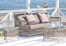 Outdoor couch with pink pillows